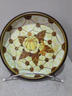 Charles CATTEAU (1880-1960). Plat en céramique à décor de fleurs chez Maître Jean-Louis Vedovato et ARTCURIAL TOULOUSE VEDOVATO- RIVET   interencheres.com