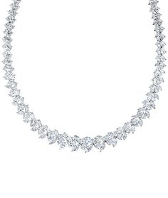 Sparkling clusters of diamonds in a repeating leaf pattern, with marquise, pear-shape and round brilliant-cut diamonds in a platinum setting - Cellini Jewelers