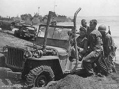 US soldiers pushing jeep. New Guinea, 15 September 1944. Australian War Memorial Photo
