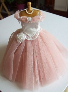 Handmade 1/12 scale dollhouse miniature peachy/pink net and ivory silk gown on mannequin. $75.00, via Etsy.