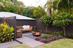 Cooparoo 3 - tropical - landscape - brisbane - Utopia Landscape Design, small yard, fire pit, wood benches, tropical plants