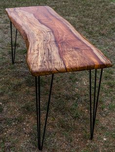 """Striking Garvinworks spalted pecan slab desk. The desk features live edges, finished with multiple coats of varnish and hand rubbed to a satin finish, then waxed. The powder coated hairpin legs by """"The Old Timber Mill"""" are hand made in Ohio using 100% US steel."""