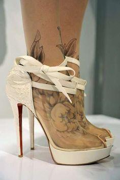 Tattooed feet in Loubutins