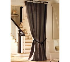 I like curtain-going-into-another-room look. Doesn't always have to be with a window!