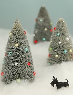 """DIY Bottle Brush Trees - Packs of Bottle Brushes (dollar store). Fill sink or container w/bleach & water. Soak brushes until they are the shade that you want. Rinse, dry. Cut the wire of the brush at least 1"""" below the end of your brushes. Then trip brush to resemble the shape of a Christmas tree. Add flocking or glitter if you want to."""