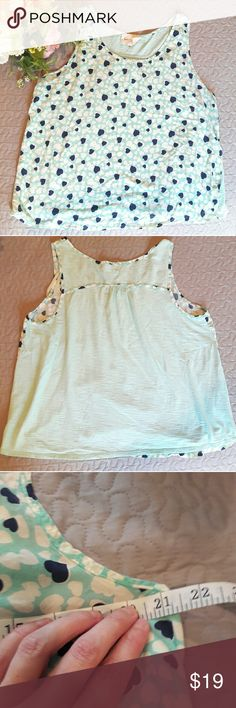 Vince Camuto heart top In great condition! Very cute mint, white and navy blue top. Has hearts all over the front. Sleeveless. Very lightweight. Bust and length Measurements provided in pics above. True to size. From a smoke and pet free home. Fast shipping! Office - Vacation - Wedding - Fun - Dress up - date night - cruise - spring - summer *IF YOU LIKE MY ITEMS, please FOLLOW ME to see NEW ARRIVALS that are added weekly! * Two by Vince Camuto Tops