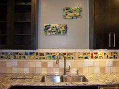 My friend, Cat Rosengren, who is a tile artist just completed work for a client. She used her handmade jewel tiles that you can buy at http://www.lakotatilestudio.com