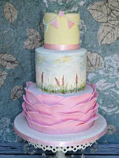 Baby shower cake with ruffles and hand painted wild flowers. Karens Kakes