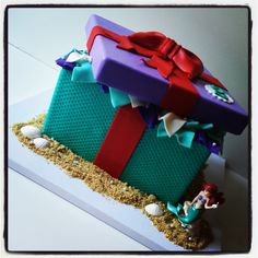 Little Mermaid / Ariel inspired Gift Box - This cake was inspired by The Little Mermaid. I wanted to put a different spin on the Ariel cakes that have been created.  The bottom represents her tail scales,  the lid represents her shell top, and the red bow, of course, represents her hair.