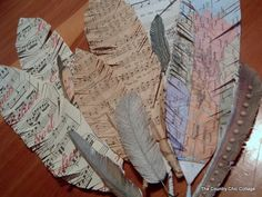 Angie from TheCountryChicCottage came up with recycled paper feathers. Swoon.