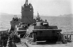 Japanese Ka-Mi amphibious tanks on board a transport ship