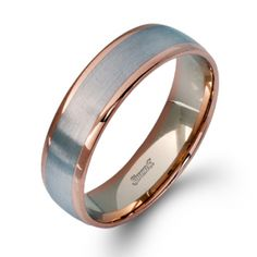 ($1870) Simon G. Men's Wedding Band, from Diamonds Direct. Featuring a modern twist on the classic wedding band design, this contemporary men's wedding band has an eye-catching appearance. #simong #mens #weddingband #mensring