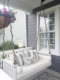 Grey and white are natural color companions, working together to create a smooth, modern color palette. This gorgeous porch swing in Superwhite SW 6995 makes a clean contrast against the Westchester Gray SW 2849 home exterior.