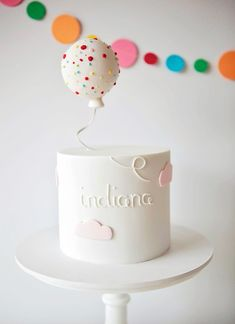 Awww! This mini birthday cake with a floating balloon topper is too adorable.