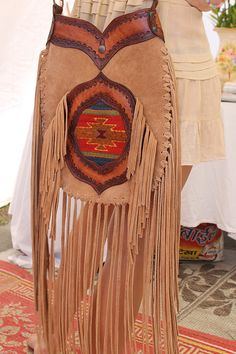 Mod western fringed cross body with native american print inset. So much fringe!