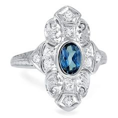 The Preston Ring.  This incredible Art Deco ring showcases a bezel set center sapphire surrounded by a gorgeous display of diamond accents, milgrain and engraving