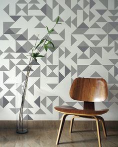 I am in the market for some fun wallpaper for one accent wall in our kitchen. In the midst of my exhaustive search, I came across this amazing geometric, embroidered wallpaper.