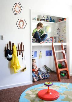 Reading nook made out of closet. Perfect for an extra room turned playroom.  LOVE the mobile and little ladder