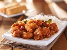 plate of chinese general tsos chicken with rice and broccoli - plate of Chinese…