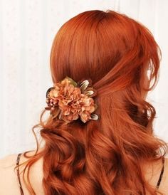 curly light red hair with flowers