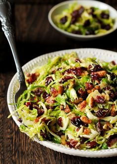 This delicious Honey Mustard Brussels Sprout Salad with Cranberries and Pecans is all about crisp, shredded Brussels sprouts tossed with slightly sweet honey mustard vinaigrette, dried cranberries and chopped pecans. Cranberry Salad, Cranberry Chicken, Sprouts Salad, Brussel Sprout Salad, Brussels Sprouts, Vegetable Side Dishes, Vegetable Recipes, Best Salad Recipes, Healthy Recipes