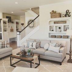 A very neutral living room with beige, white and brown