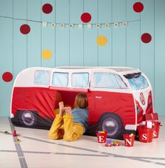 Not to be outdone by their parents, these new licensed T1 VW Camper Van Play Tents are just what every hip and happening kid needs this summer. Perfect indoors and outdoors, these new mini-me versions of the iconic 1965 Split Screen VW Camper Van are too cool for school.This is an easy pop up tent, no pegging or complicated instructions, just take it out of its carry case and pop it up! The front and rear windows can also open and close.Available in blue or red, the kids VW tent is perfect…