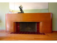 Hubby wants to do this to the fireplace in our new house. It's fantastic, but...we'll see! Not sure where we'd get the wood...
