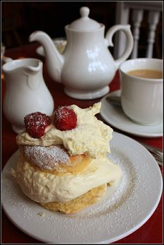 """Cream tea, a simpler version of afternoon tea, calls only for scones, jam, clotted or Devonshire cream, and tea. This is a much less elaborate tea to plan for guests."" -- taken from the book ""Scones Tea: The Ultimate Collection of Recipes for Teatime"" by Lorna Reeves / Photo: Cream Tea at Peterhead, Scotland by Katrinh"