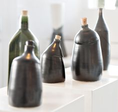 Ceramic sculptural bottles. Use decorative, for oil or snaps. Thorwn and altered handmade ceramics.