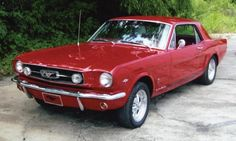 '66 Ford Mustang in red.  My dream since childhood to own a little red sports car.