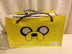 Jake the dog reusable shopping / tote bag.  Made using 40 recycled plastic bags.  The ultimate in eco friendly, It saves you from getting more plastic bags and used up a huge quantity in its construction and diverts them from landfills and waterways. Each bag is strong and sturdy and built to last. Perfect for grocery shopping or a trip to the beach or pools..   The perfectly unique gift for anyone.    Environmentally friendly.  The real GREEN choice.