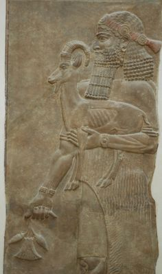 Person holding an ibex and a poppy flower. Low-relief from the m wall of king Sargon II's palace at Dur Sharrukin in Assyria (now Khorsabad in Iraq), c. 713–716 BC. From Paul-Émile Botta's excavations in 1843–1844. Courtesy currently located at theLouvre, France. Photo taken byJastrow