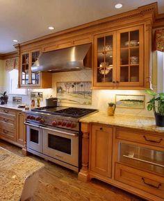 http://www.kitchens.com/photos/designer-kitchens/country-kitchens/tile-backsplash-mural/image
