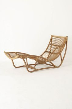 """Handwoven rattan takes on a simple, curving shape, matching your every contour as you drift into a blissfully at-ease state. Suitable for outdoor use Rattan 30""""H, 23""""W, 50""""D Seat: 9""""H"""