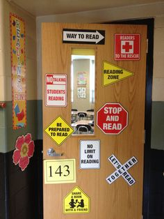 """My classroom door... Road signs bc """"Reading Takes You Paces!"""""""