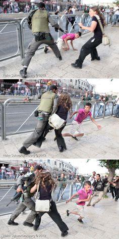 A 22 year-old Israeli activist from Jerusalem named Sahar Vardi, prevents Israeli officer from arresting Palestinian child. Photos by Photojournalist Haim Schwarczenberg