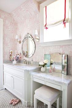 Single sink & vanity. Marble & wallpaper
