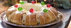 """Rosca de Reyes Recipe (Three Kings Bread) is a round-shaped Mexican and Spanish bread garnished with """"jewels"""" to represent a crown and a """"baby doll"""" inside to celebrate Epiphany. Kings Bread, Spanish Bread, Candied Orange Peel, Cherry Candy, Christmas Foods, Yeast Bread, Epiphany, Dinner Rolls, Different Recipes"""