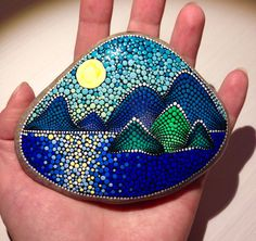 Sunset above the sea Painted stone painted by CreateAndCherish