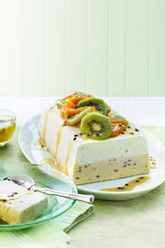Layered Lime, Mango and Passionfruit Ice Cream Terrine with white chocolate and kiwi fruit. Frozen dessert perfect for summer parties.