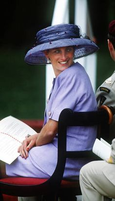 HRH Diana, Princess of Wales wore this purple oversized hat by Philip Somerville to the June 1994 Canadian memorial dedication in Green Park, London. The dress was  a Catherine Walker suit .