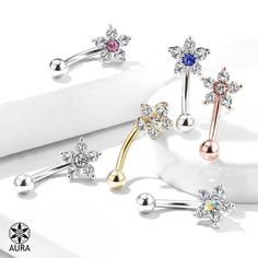 Dazzling Flower Crystal Curved Barbell - Eyebrow Ring Size Thickness: Length: Ball Size: Materials: Surgical Steel & Brass Plating: Gold Sold by the Piece Choose Your Color: Clear Clear/Aurora Borealis Clear/Blue Clear/Pink Gold/Clear Rose Gold/Clear Rook Piercing Jewelry, Barbell Piercing, Piercings, Daith Earrings, Wholesale Body Jewelry, Eyebrow Ring, Brass Jewelry, Pink Jewelry, Sell Gold