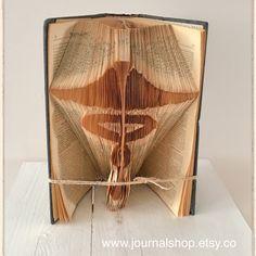 Book folding Caduceus- the medical symbol!