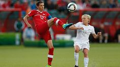 Canadian Christine Sinclair, left, kicks the ball in front of Betsy Hassett of New Zealand, right, during the game Thursday in Edmonton. Us Soccer, Soccer Fans, World Cup Tickets, Fifa Women's World Cup, Vancouver, Thursday, Kicks, Canada, Game