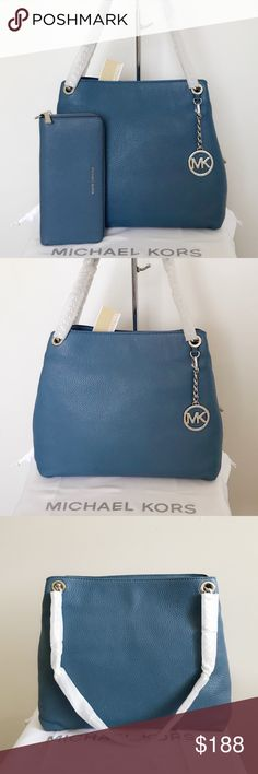 NWT Michael Kors Jet Set Chain Tote & Wallet Beautiful set! Blue soft leather and silver detailing. Great for all occasions. Authentic. Wallet 's color is a little bit darker than the purse's.  The large chain tote is new with tags.   The wallet is missing the strap, other than that in really good condition.  Measurements: 12*9.5*4 inch  Dust bag is included Michael Kors Bags Totes