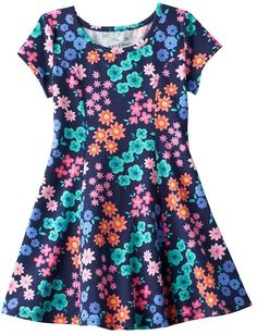 Featuring princess seams, this girls' Jumping Beans skater dress offers a flattering look for your already adorable little girl. PRODUCT FEATURES Scoopneck Short sleeves All-over pattern Cotton, spandex Machine wash Imported