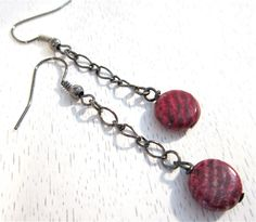 Small red coin beads on gunmetal chain earrings. $16.00, via Etsy.