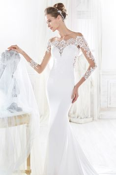 Nicole romantic mermaid enriched with macrame lace and tulle.