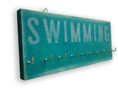 For all my swimming medals!